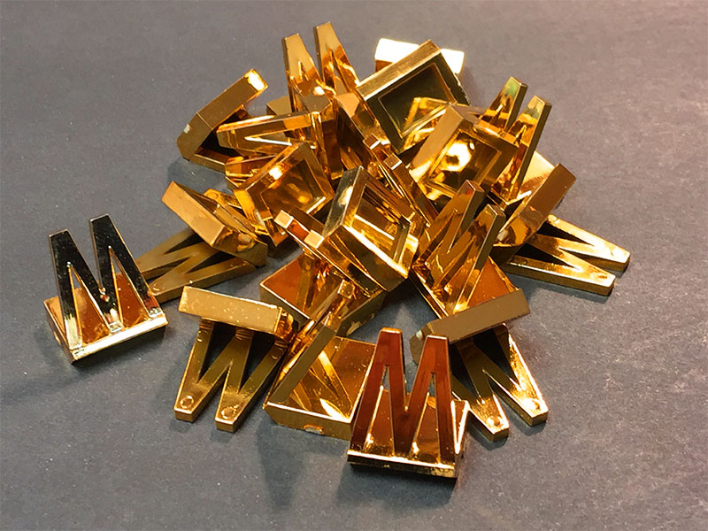 plastic pieces gold plated game pieces